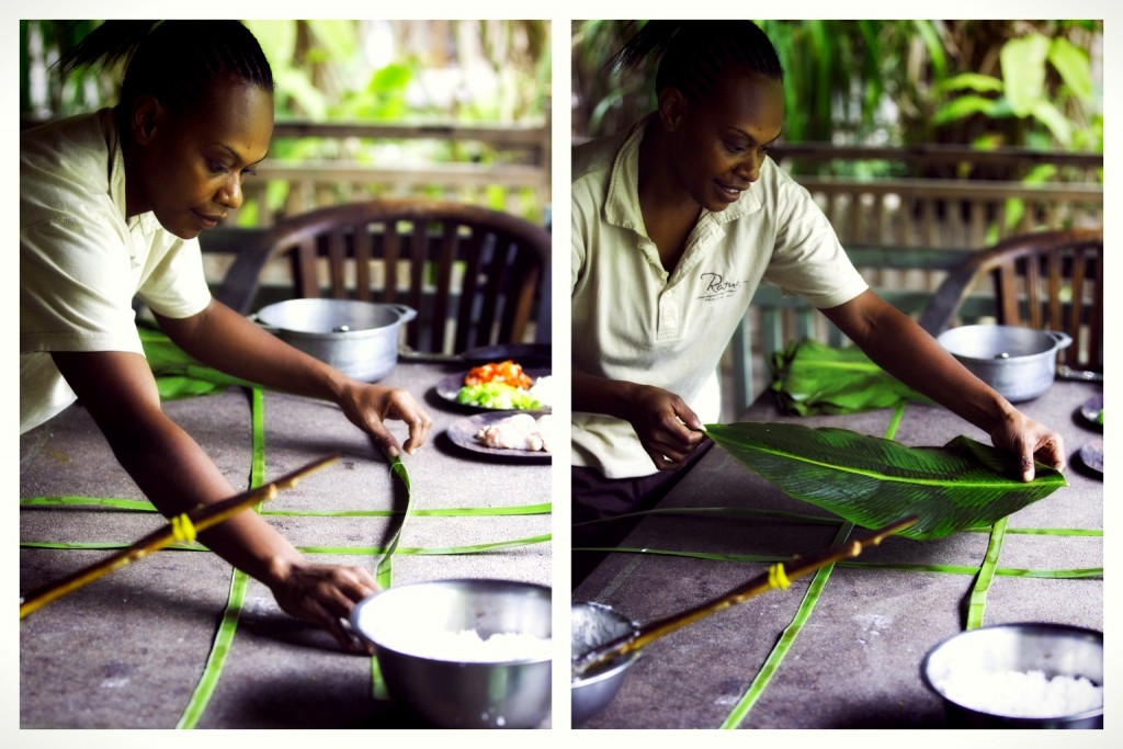 Carefully laying out the banana leaves to wrap the lap lap in